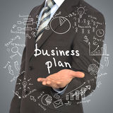 Man in suit holding business plan Stock Photo