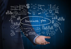 Man in suit holding business plan Royalty Free Stock Photo