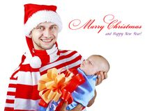 A man in a suit holding a Christmas a little child Royalty Free Stock Images