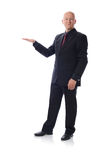 Man in suit holding copy space. Man in suit holding empty copy space Royalty Free Stock Photos