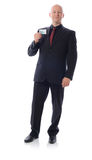 Man in suit holding credit card. On white Stock Images