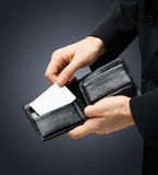 Man in suit holding credit card Royalty Free Stock Image