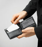 Man in suit holding credit card Stock Photo