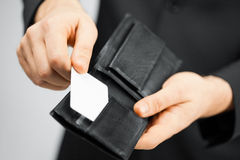 Man in suit holding credit card Royalty Free Stock Photo