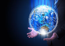 Man in suit holding a earth in hand Royalty Free Stock Images