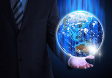 Man in suit holding a earth in hand Stock Photo