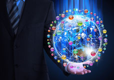 Man in suit holding a earth in hand Royalty Free Stock Photos