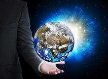 Man in suit holding a earth in hand Stock Photos