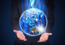 Man in suit holding a earth in hand Royalty Free Stock Photography