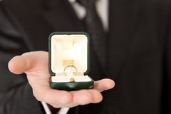 Man in suit holding engagement ring Stock Photography