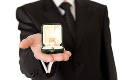 Man in suit holding engagement ring Royalty Free Stock Images