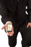 Man in suit holding engagement ring Stock Photo