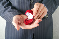Man in suit holding engagement ring Royalty Free Stock Image