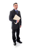 Man in suit holding file folder. A business man in blue shirt and tie holding a file folder looking forward, confident stock photo