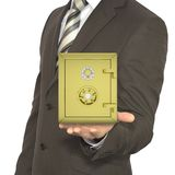 Man in a suit holding gold safe Royalty Free Stock Photo