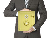 Man in a suit holding gold safe Stock Photos