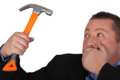 Man in suit holding hammer Royalty Free Stock Photography