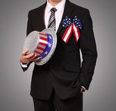 Man in suit holding Hat with American Flag Royalty Free Stock Images
