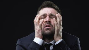 Man in suit holding head and screaming, schizophrenia problems, mental disorder. Stock footage stock video