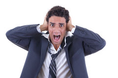 Man in suit holding his head and screaming Stock Photo