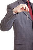 Man in suit  holding key Stock Photo