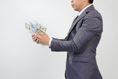 Man in suit holding knife and korean won Stock Photos