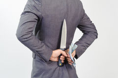 Man in suit holding knife and korean won Royalty Free Stock Photo