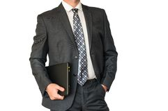 Man in suit holding laptop Stock Photo