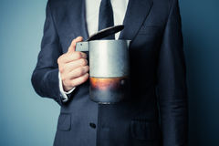 Man in suit holding a moka pot Royalty Free Stock Images