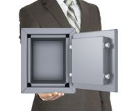 Man in a suit holding open safe Stock Image