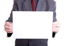 Man in suit holding out blank sign Stock Images