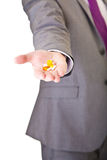 Man in suit holding pills isolated Royalty Free Stock Images