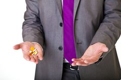 Man in suit holding pills isolated Royalty Free Stock Image