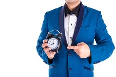 Man in suit holding and point to the clock over white Royalty Free Stock Photography