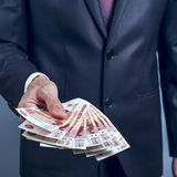 Man in a suit holding Russian rubles Stock Photography