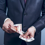 Man in a suit holding Russian rubles Royalty Free Stock Photography
