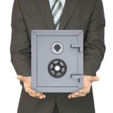Man in a suit holding a safe Stock Photos