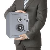 Man in a suit holding a safe Royalty Free Stock Photo