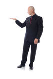 Man in suit holding space. Man in suit holding empty copy space Royalty Free Stock Photos