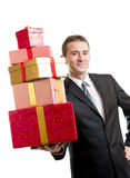 Man in suit holding a stack of presents Stock Photo