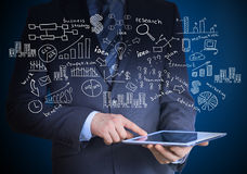 Man in suit holding tablet pc Royalty Free Stock Image