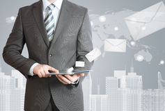 Man in suit holding tablet pc Stock Photo