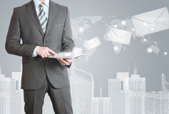 Man in suit holding tablet pc Stock Photography