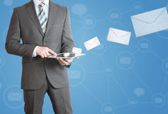 Man in suit holding tablet pc. Mailing concept Royalty Free Stock Photography