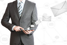 Man in suit holding tablet pc. Mailing concept Royalty Free Stock Photos