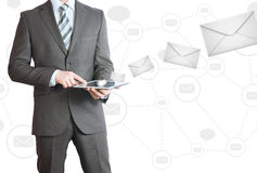 Man in suit holding tablet pc. Mailing concept Stock Photo