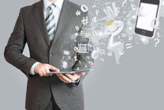 Man in suit holding tablet pc. Office work concept Stock Photography