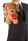 Man in suit  holding teddy bear Stock Photo