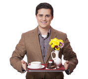 Man in suit holding tray with sweet breakfast Royalty Free Stock Photo