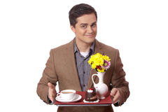 Man in suit holding tray with sweet breakfast Stock Images